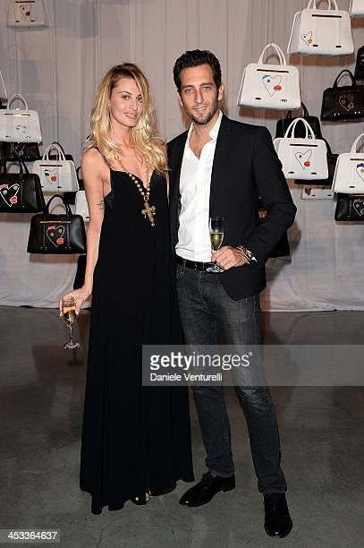 Sveva Alviti and Francesco Pozzessere attend the Porsche Design x Thierry Noir Art Basel Miami Beach Event at The Temple House on December 3 2013 in...