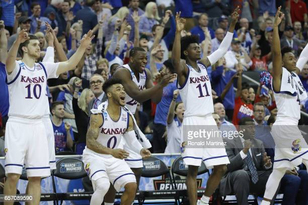 Sviatoslav Mykhailiuk Frank Mason III Dwight Coleby Josh Jackson and Devonte' Graham of the Kansas Jayhawks celebrate defeating the Purdue...