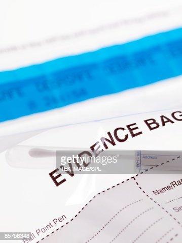 Swab sample from crime scene inside a forensic evidence bag