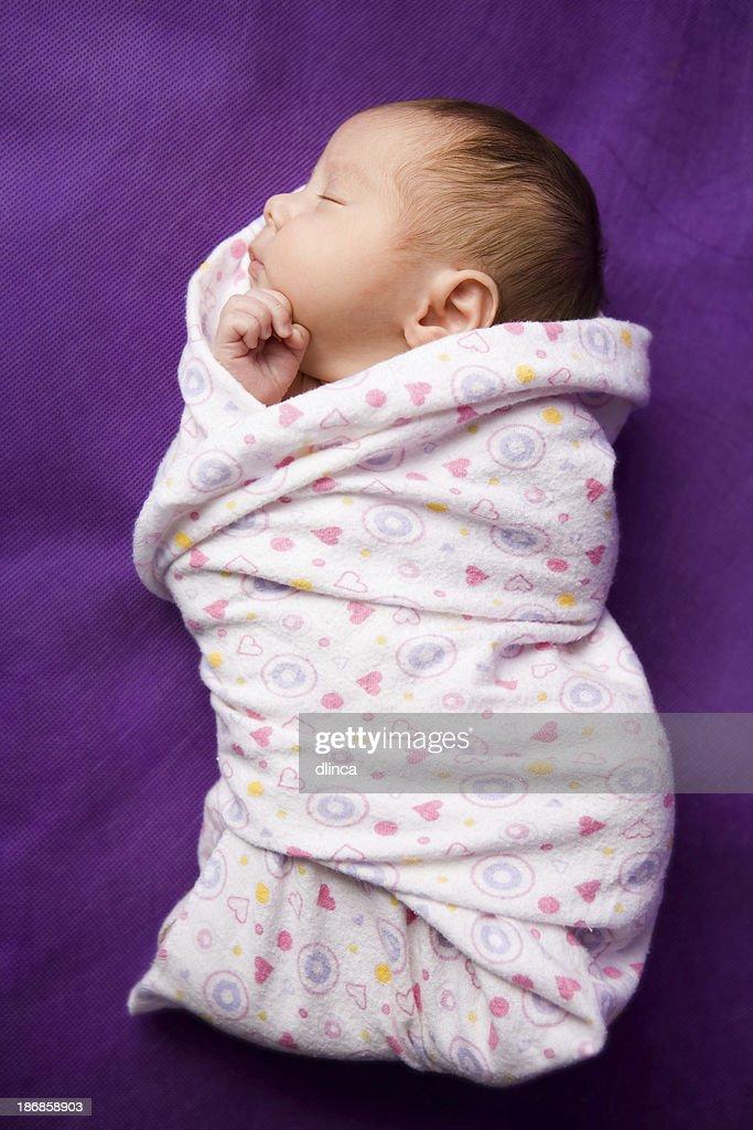 swaddled newborn - full length image