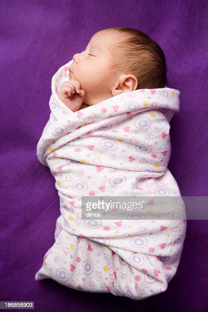 swaddled newborn - full length image