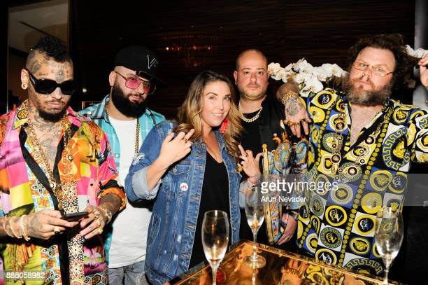 Swaggman Jeremy Royzin Anita Autiero Corey Shapiro and Slobby Robby pose during the cocktail reception at Vagu on December 7 2017 in Miami Florida