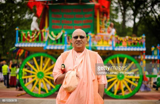 Swami Atmanivedana with one of three 40foot high chariots during the Hare Krishna Rathayatra Festival of Chariots in Hyde Park central London