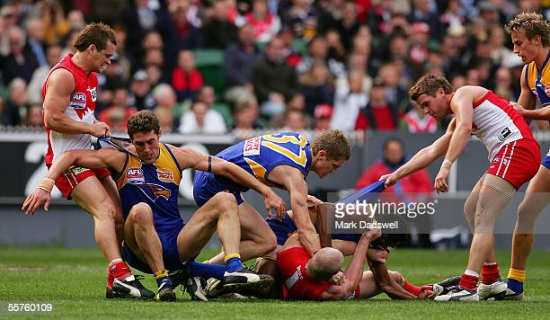 Swans and Eagles players scuffle off the ball during the 2005 AFL Grand Final between the Sydney Swans and the West Coast Eagles at the Melbourne...