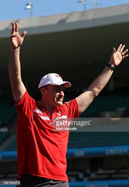 Swans Coach John Longmire acknowledges the crowd during the Sydney Swans AFL Grand Final celebrations at Sydney Cricket Ground on September 30 2012...