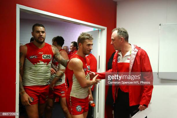 Swans coach John Longmire congratulates Kieren Jack of the Swans after winning the round 12 AFL match between the Sydney Swans and the Western...