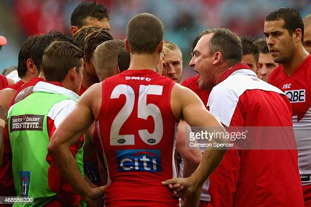 Swans coach John Longmire talks to players at quartertime during the Round One AFL match between the Sydney Swans and the Essendon Bombers at ANZ...