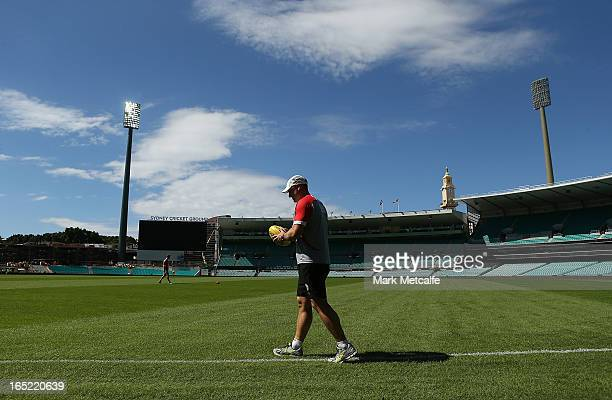 Swans coach John Longmire walks onto the field prior to a Sydney Swans AFL training session at the Sydney Cricket Ground on April 2 2013 in Sydney...