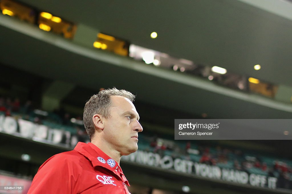 Swans coach John Longmire walks onto the field prior to the round 10 AFL match between the Sydney Swans and the North Melbourne Kangaroos at Sydney Cricket Ground on May 27, 2016 in Sydney, Australia.