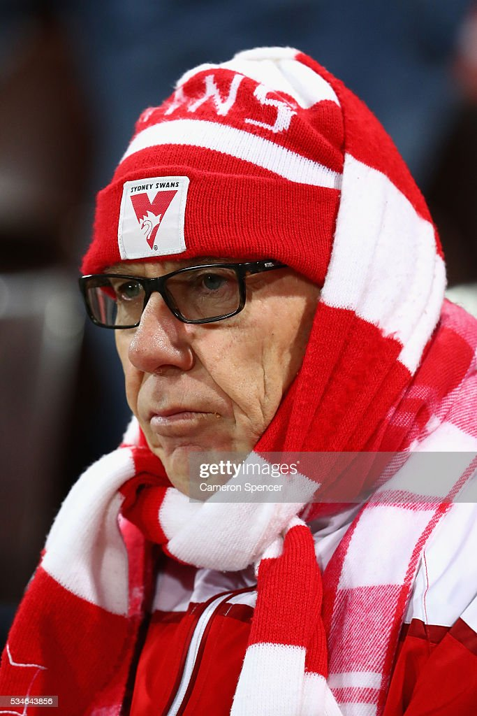 A Swans fan shows his colours during the round 10 AFL match between the Sydney Swans and the North Melbourne Kangaroos at Sydney Cricket Ground on May 27, 2016 in Sydney, Australia.