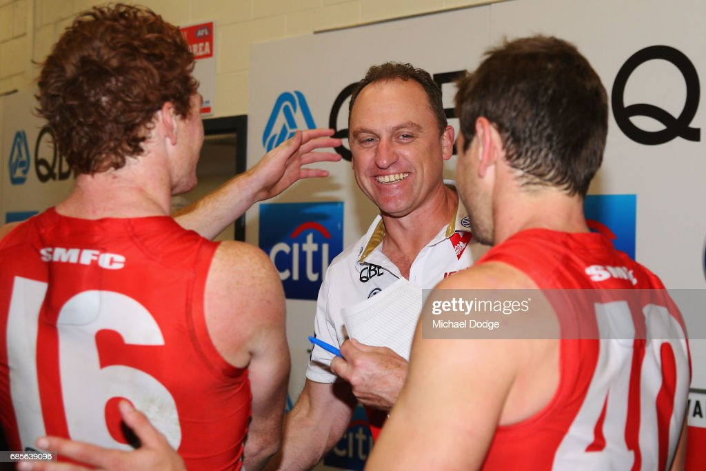 Swans head coach John Longmire celebrates the win with Gary Rohan and Nick Smith of the Swans (R) during the round nine AFL match between the St Kilda Saints and the Sydney Swans at Etihad Stadium on May 20, 2017 in Melbourne, Australia.