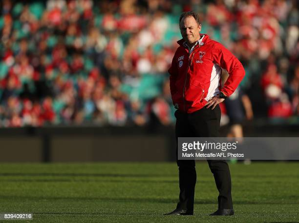 Swans head coach John Longmire looks on before the round 23 AFL match between the Sydney Swans and the Carlton Blues at Sydney Cricket Ground on...