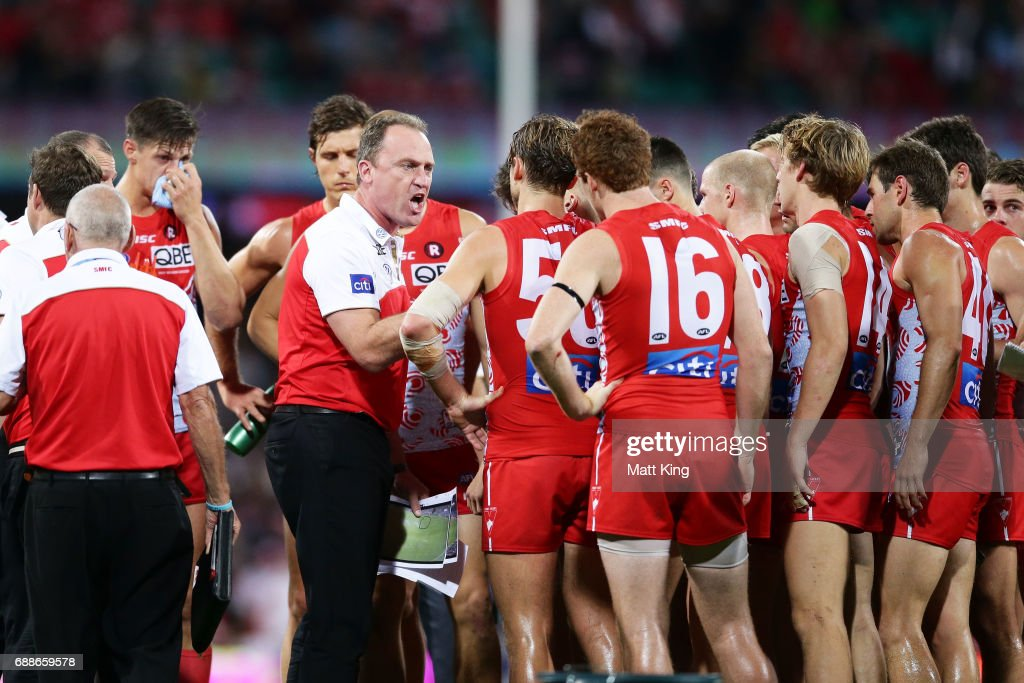 Swans head coach John Longmire speaks to players at quarter time during the round 10 AFL match between the Sydney Swans and the Hawthorn Hawks at Sydney Cricket Ground on May 26, 2017 in Sydney, Australia.