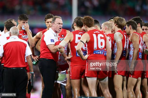 Swans head coach John Longmire speaks to players at quarter time during the round 10 AFL match between the Sydney Swans and the Hawthorn Hawks at...