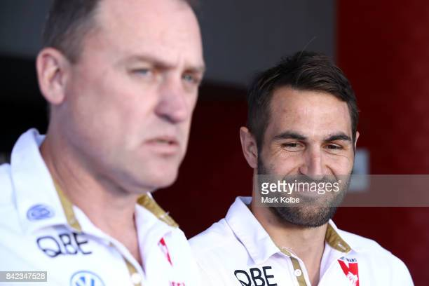 Swans head coach John Longmire speaks to the media as Swans captain Josh Kennedy smiles during a Sydney Swans AFL media opportunity at Sydney Cricket...
