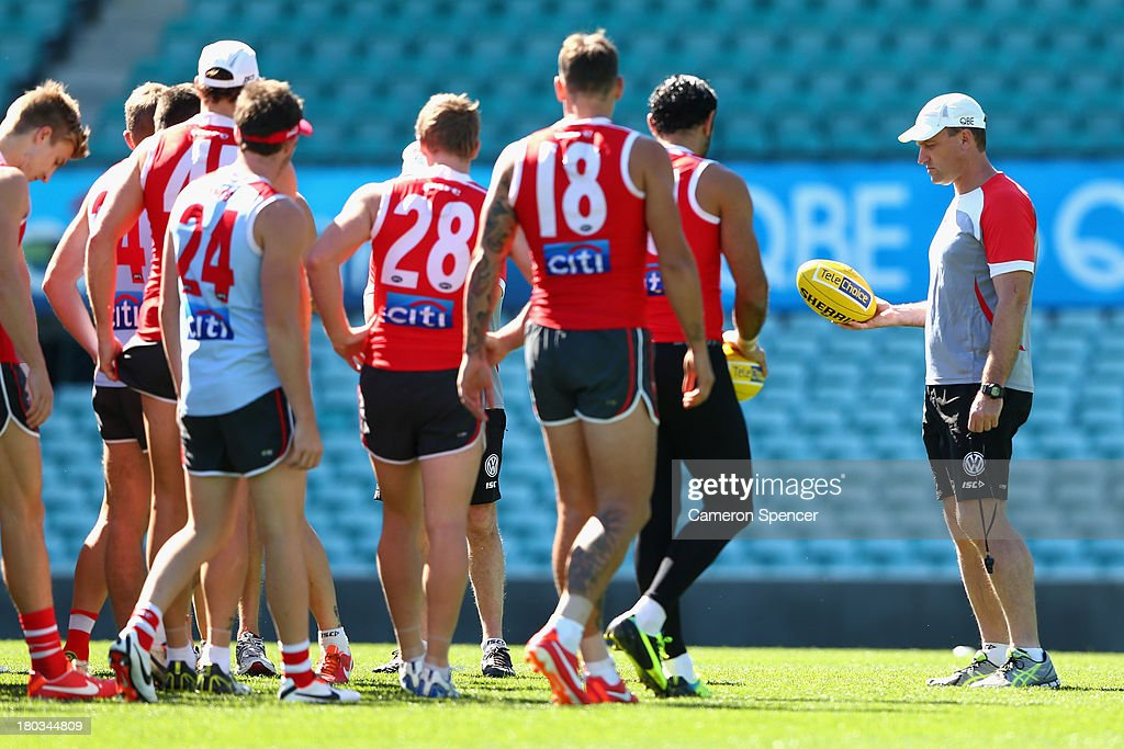 Swans head coach John Longmire talks to players during a Sydney Swans AFL training session at Sydney Cricket Ground on September 12, 2013 in Sydney, Australia.