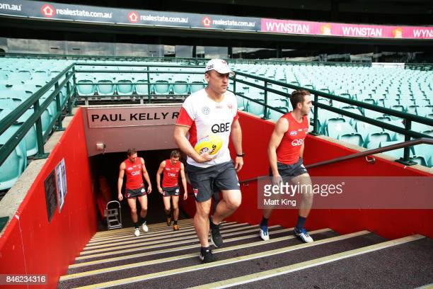 Swans head coach John Longmire walks onto the pitch during a Sydney Swans AFL training session at Sydney Cricket Ground on September 13 2017 in...