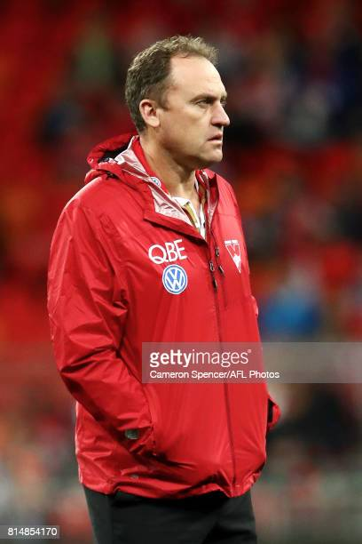 Swans Head coach John Longmire watches his team warm up during the round 17 AFL match between the Greater Western Sydney Giants and the Sydney Swans...