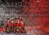Swans players celebrate victory after the 2005 AFL Grand Final between the Sydney Swans and the West Coast Eagles at the Melbourne Cricket Ground...