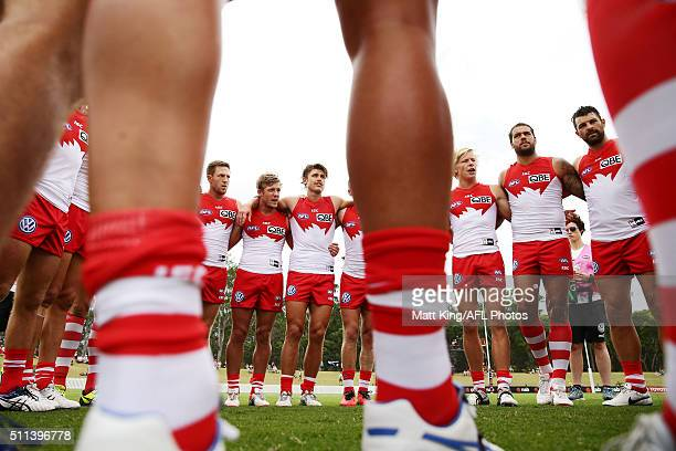 Swans players form a huddle just before kick off during the 2016 NAB Challenge AFL match between the Sydney Swans and Port Adelaide Power at...