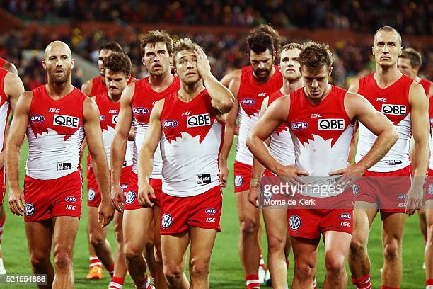 Swans players leave the field after losing the round four AFL match between the Adelaide Crows and the Sydney Swans at Adelaide Oval on April 16 2016...