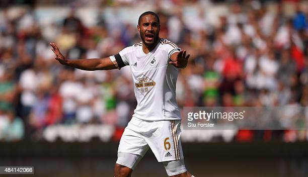 Swansea captain Ashley Williams in action during the Barclays Premier League match between Swansea City and Newcastle United at the Liberty stadium...