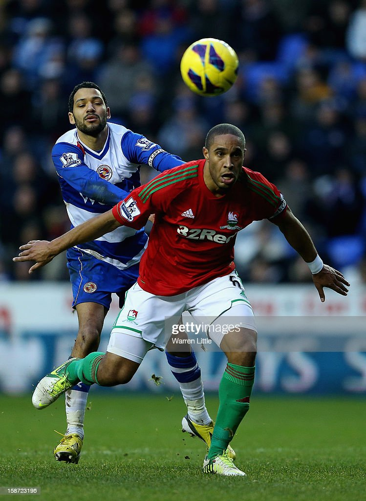 Swansea Captain, Ashley Williams is challenged by Reading Captain Jobi McAnuff during the Barclays Premier League match between Reading and Swansea City at Madejski Stadium on December 26, 2012 in Reading, England.