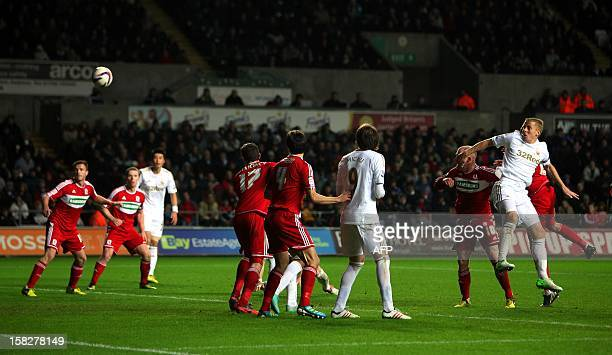 Swansea captain Garry Monk scores the winning goal during the League Cup quarter final match played between Swansea City FC and Middlesbrough FC at...