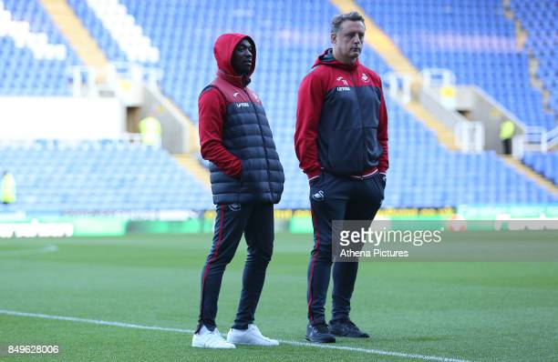 Swansea City assistant manager Claude Makelele and Swansea City goalkeeper coach Tony Roberts prior to kick off during the Carabao Cup Third Round...