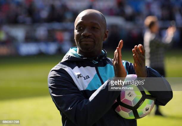 Swansea City Assistant manager Claude Makelele thanks home supporters after the Premier League match between Swansea City and West Bromwich Albion at...