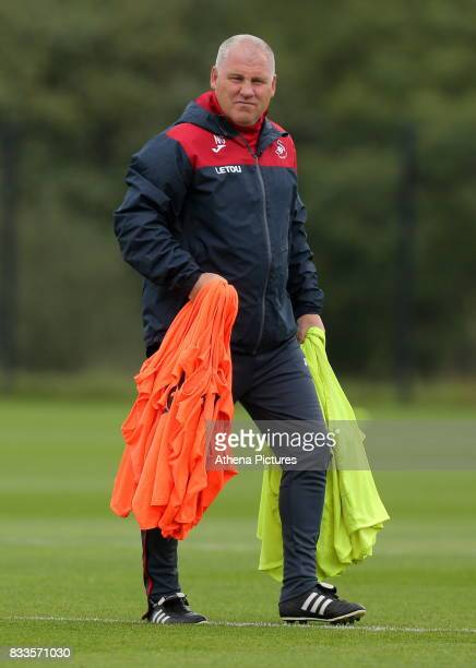 Swansea City Assistant manager Nigel Gibbs carries vests during the Swansea City Training at The Fairwood Training Ground on August 16 2017 in...