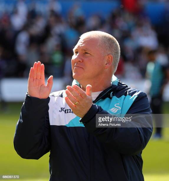 Swansea City Assistant manager Nigel Gibbs thanks home supporters after the Premier League match between Swansea City and West Bromwich Albion at The...