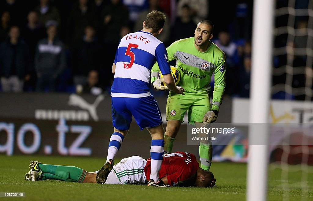 Swansea City Captain, Ashley Williams clashes with Adam Federici of Reading during the Barclays Premier League match between Reading and Swansea City at Madejski Stadium on December 26, 2012 in Reading, England.