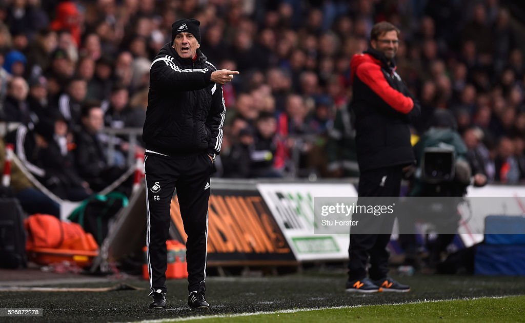 Swansea City coach <a gi-track='captionPersonalityLinkClicked' href=/galleries/search?phrase=Francesco+Guidolin&family=editorial&specificpeople=770478 ng-click='$event.stopPropagation()'>Francesco Guidolin</a> reacts during the Barclays Premier League match between Swansea City and Liverpool at The Liberty Stadium on May 1, 2016 in Swansea, Wales.
