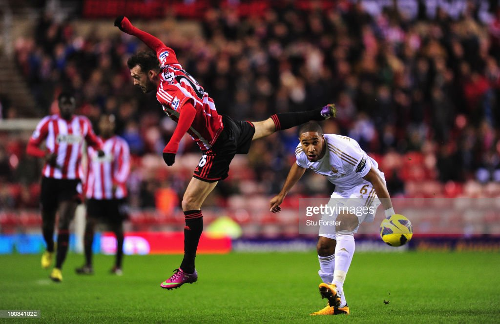 Swansea City defender Ashley Williams (r) challenges Sunderland forward Steven Fletcher during the Barclays Premier League match between Sunderland and Swansea City at Stadium of Light on January 29, 2013 in Sunderland, England.