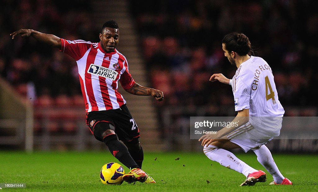 Swansea City defender Chico Flores challenges Sunderland forward Stephane Sessegnon during the Barclays Premier League match between Sunderland and Swansea City at Stadium of Light on January 29, 2013 in Sunderland, England.