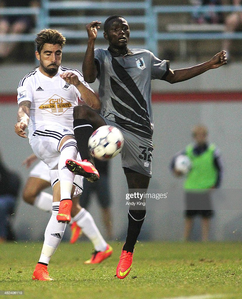 Swansea City defenseman Chico Flores (L) and Minnesota United FC middle fielder Abdiel Arroya (32) battle in the second half of their friendly soccer match on July 19, 2014 at the National Sports Center in Blaine, Minnesota. Minnesota United FC defeated Swansea City 2-0.