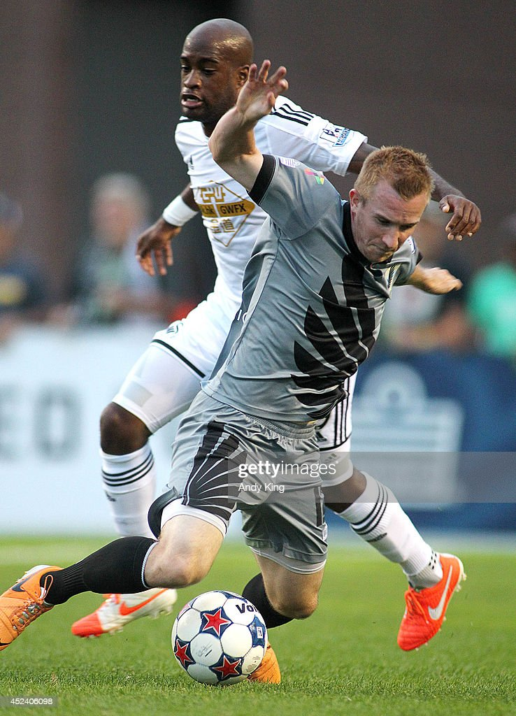 Swansea City defenseman Dwight Tiendalli fouls Minnesota United FC Jamie Watson in the second half of their friendly soccer match on July 19, 2014 at the National Sports Center in Blaine, Minnesota. Minnesota United FC defeated Swansea City 2-0.