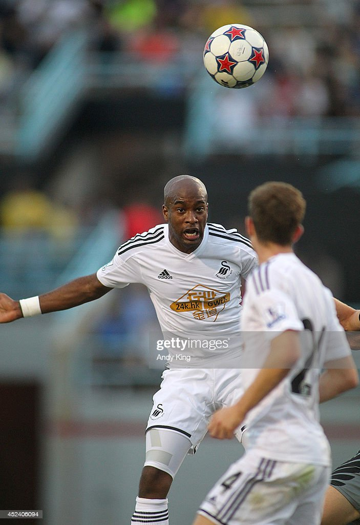 Swansea City defenseman Dwight Tiendalli heads the ball against Minnesota United FC in the second half of their friendly soccer match on July 19, 2014 at the National Sports Center in Blaine, Minnesota. Minnesota United FC defeated Swansea City 2-0.