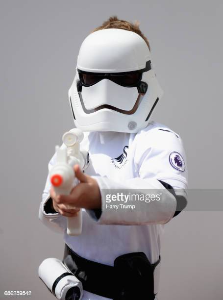 Swansea City fan dressed as a storm trooper is seen priro to the Premier League match between Swansea City and West Bromwich Albion at Liberty...