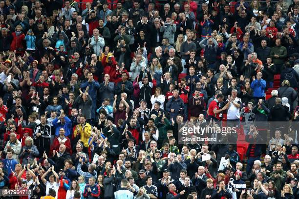 Swansea City fans cheer the final whistle during the Premier League match between Tottenham Hotspur and Swansea City at Wembley Stadium on September...