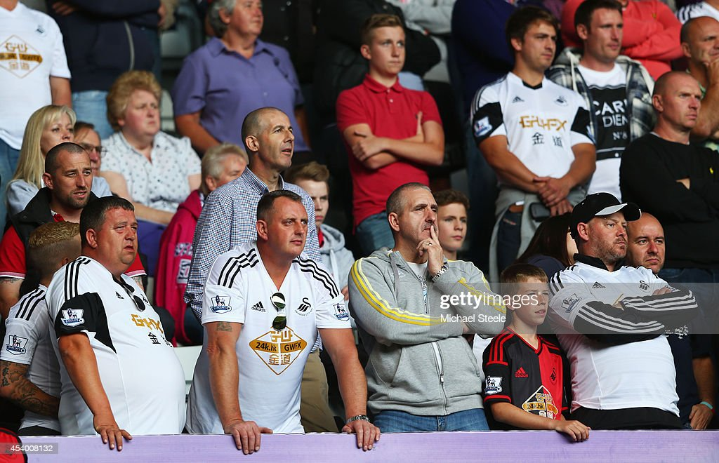 Swansea City fans look on during the Barclays Premier League match between Swansea City and Burnley at Liberty Stadium on August 23, 2014 in Swansea, Wales.