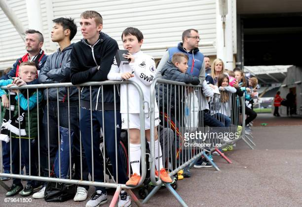 Swansea City fans wait for the teams to arrive outside the stadium prior to the Premier League match between Swansea City and Everton at the Liberty...