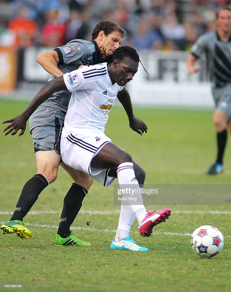 Swansea City forward Bafetibi Gomez holds off Minnesota United FC middle fielder Aaron Pitchkolan in the second half of their friendly soccer match on July 19, 2014 at the National Sports Center in Blaine, Minnesota. Minnesota United FC defeated Swansea City 2-0.