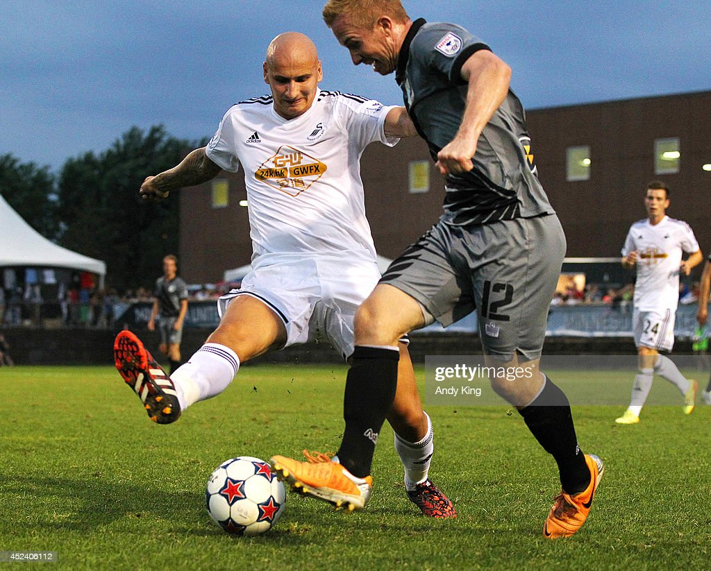 Swansea City forward middle fielder Jonjo Shelvey battles with Minnesota United FC middle fielder Jamie Watson (12) in the second half of their friendly soccer match on July 19, 2014 at the National Sports Center in Blaine, Minnesota. Minnesota United FC defeated Swansea City 2-0.