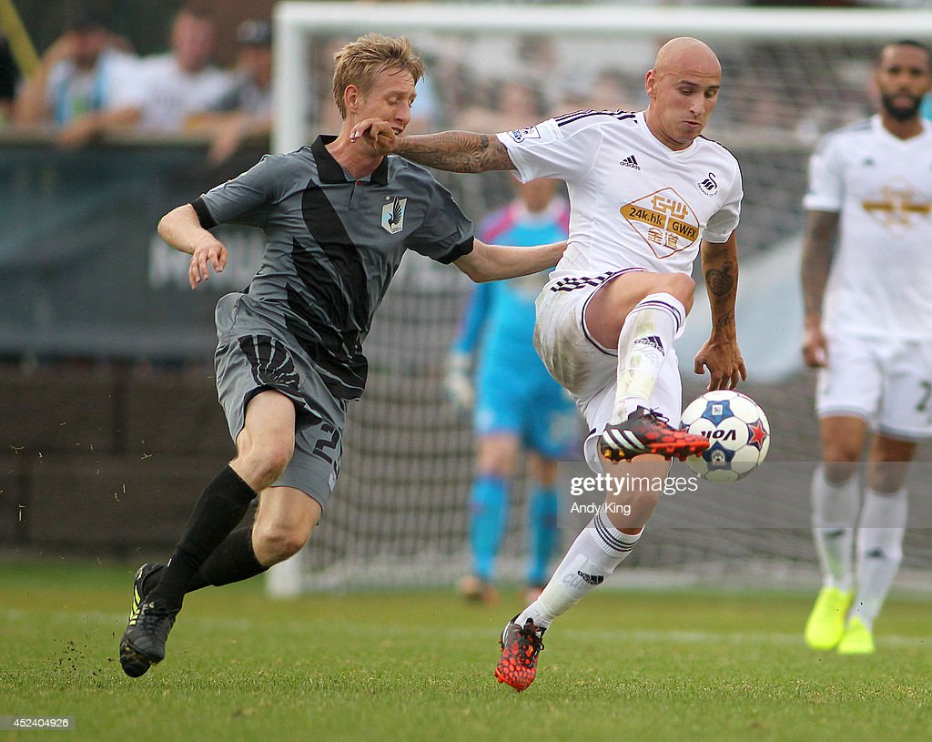 Swansea City forward middle fielder Jonjo Shelvey (9) controls the ball in front of Minnesota United FC defenseman Greg Jordan in the first half of their friendly soccer match on July 19, 2014 at the National Sports Center in Blaine, Minnesota. Minnesota United FC defeated Swansea City 2-0.