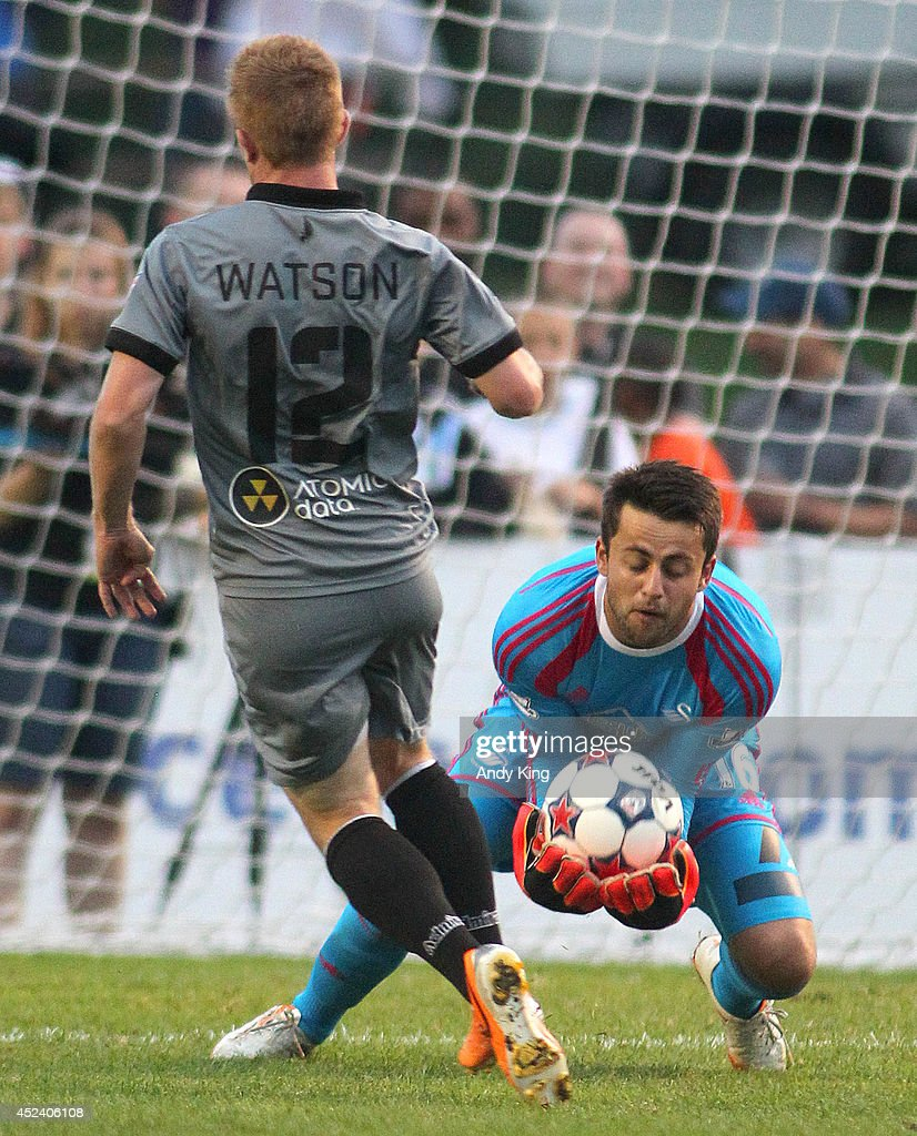 Swansea City goalie Lukasz Fabianski (16) makes a save on a play by Minnesota United FC Jamie Watson(12) in the second half of their friendly soccer match on July 19, 2014 at the National Sports Center in Blaine, Minnesota. Minnesota United FC defeated Swansea City 2-0.
