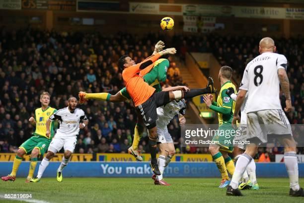 Swansea City goalkeeper Michel Vorm fails to hold onto a high ball