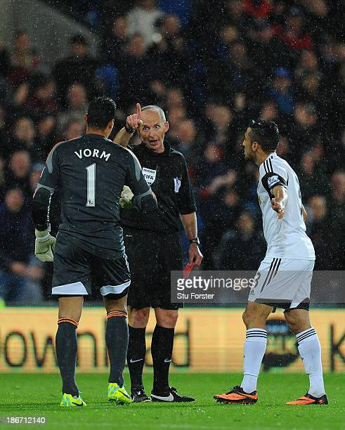 Swansea City goalkeeper Michel Vorm is sent off by referee Mike Dean during the Barclays Premier League match between Cardiff City and Swansea at...