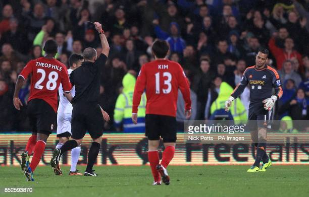 Swansea City goalkeeper Michel Vorm is shown a red card by referee Mike Dean after a foul on Cardiff City's Fraizer Campbell